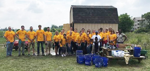 Serve360 volunteers at Lawrence Community Gardens