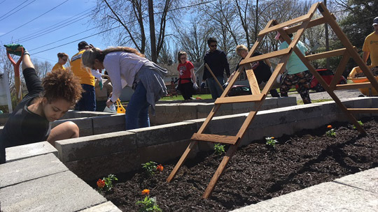 Volunteers prep a community garden on Indy's southside