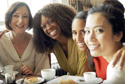 Women around a table drinking coffee