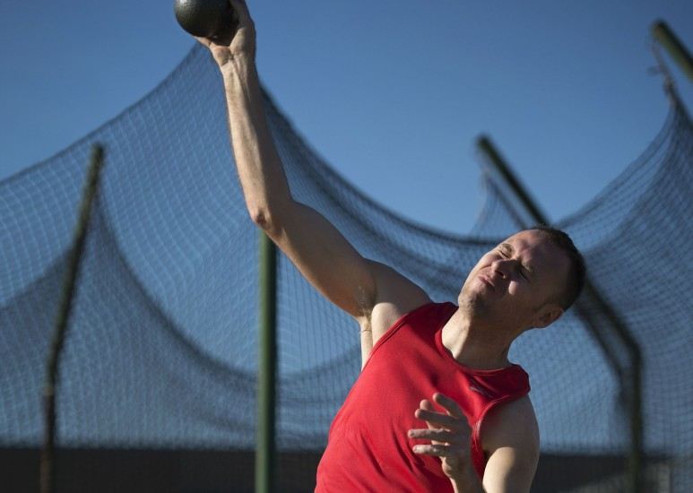 Athlete throwing shotput