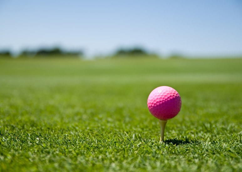 Pink golf ball for a cure