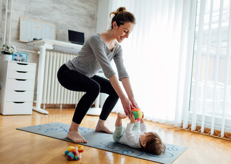 Mom exercising at home with baby