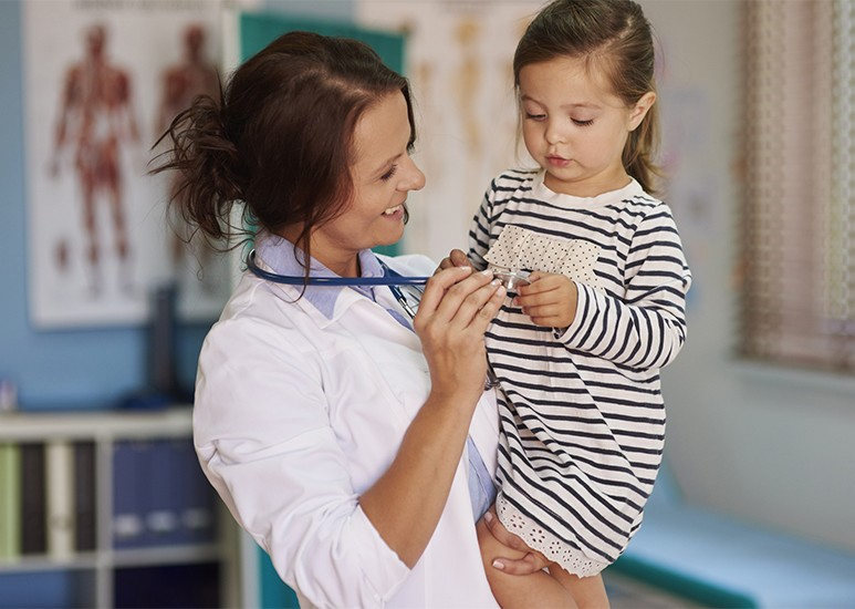 Doctor reassures a child