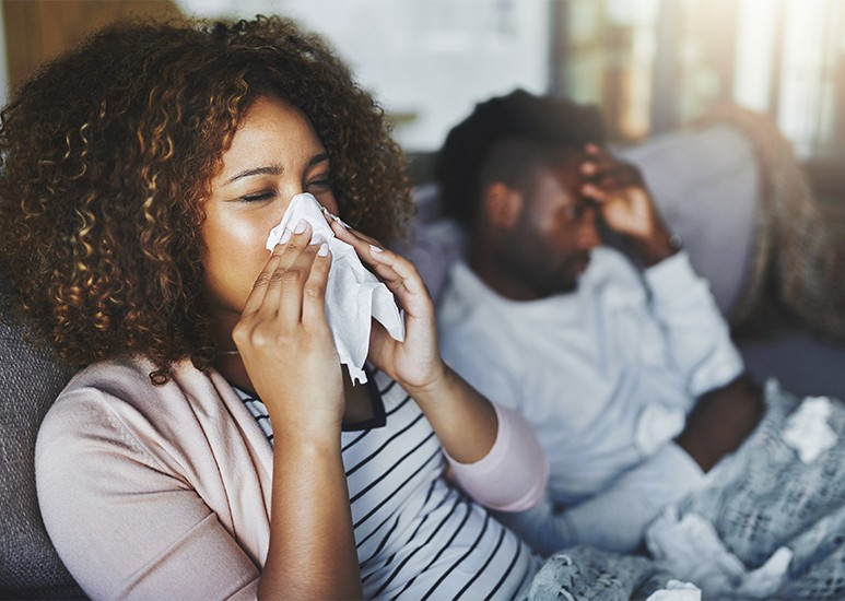 Woman and man sick with flu
