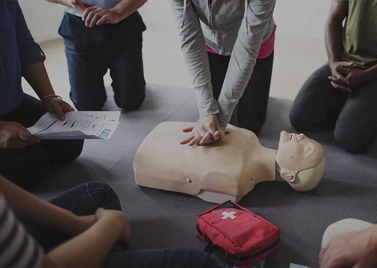 people learning how to give hands-only CPR