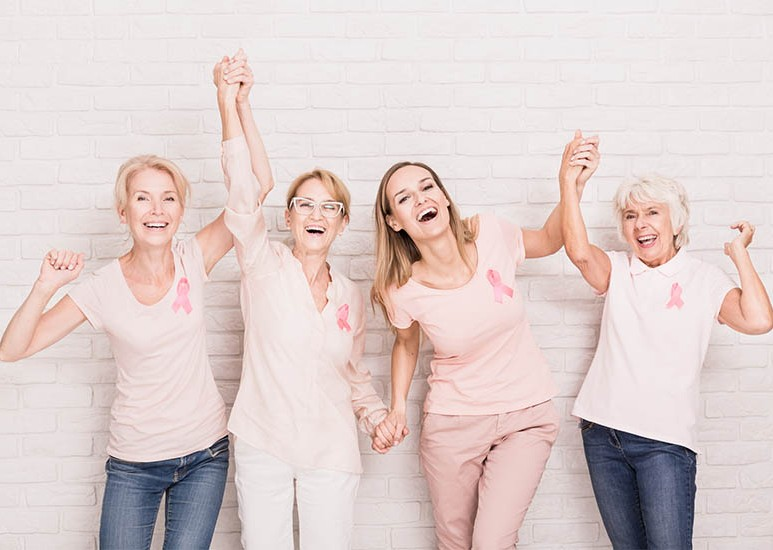 group of women wearing pink breast cancer ribbons