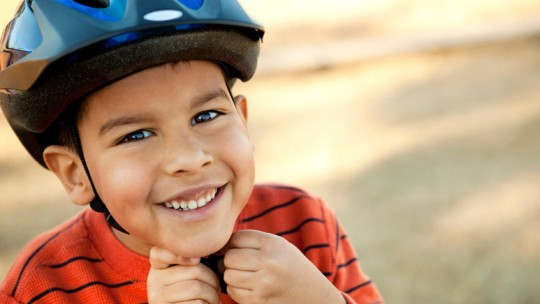 Boy wearing bicycle helmet