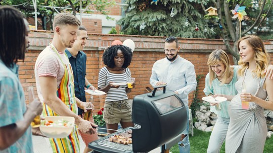 Friends grilling at a cookout
