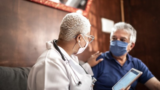 doctor talking to patient wearing masks