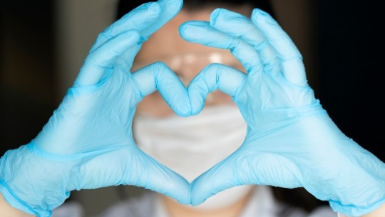 caregiver making heart with hands