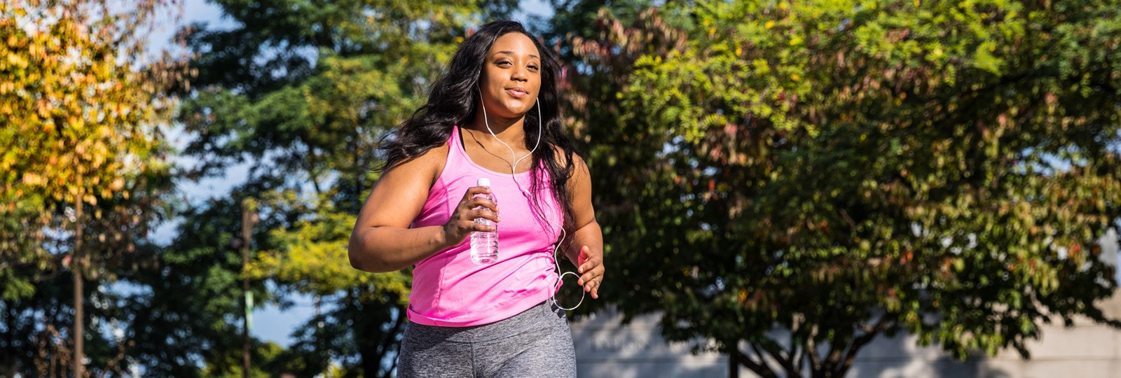 Healthy woman running outside