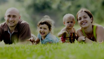 Family outdoors on grass