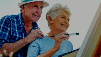 Older man and woman painting